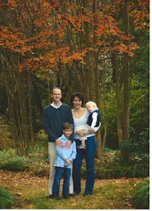 Suzanne and her family outside enjoying the woods.