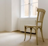 photo: single chair in an empty room
