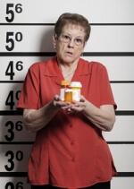 photo woman holding bottles of drugs