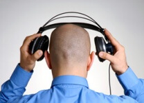 photo man listening with headphones