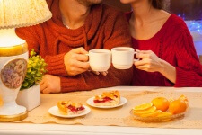 photo of man and woman at breakfast table