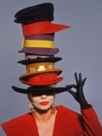 fashionable rich woman wearing stack of hats