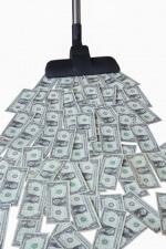 vacuum sucking up dollar bills
