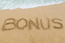 photo of word 'bonus' in the sandy beach