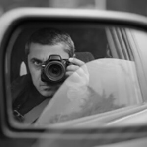 photo of private investigator photographing from car