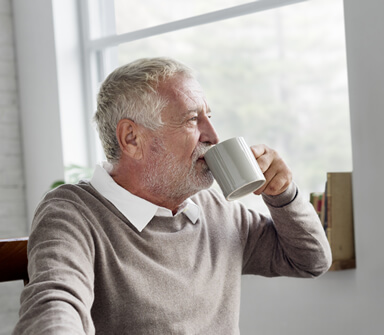 retired man sipping coffee